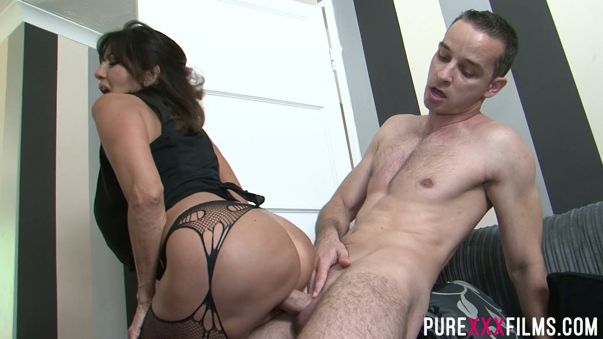 Slutty stepmom Tara Holiday spreads legs in front of her stepson