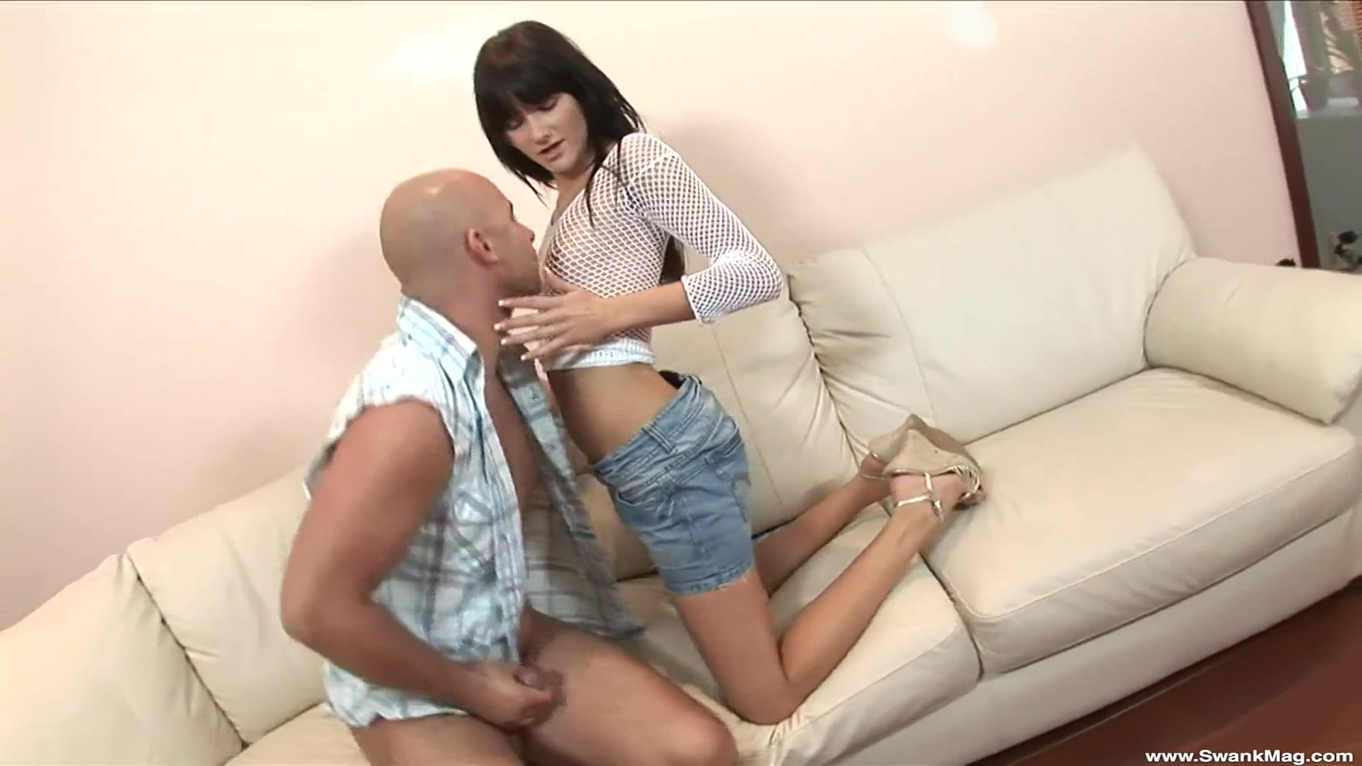 Clothed brunette Dolly Darkley rides a long wiener and moans