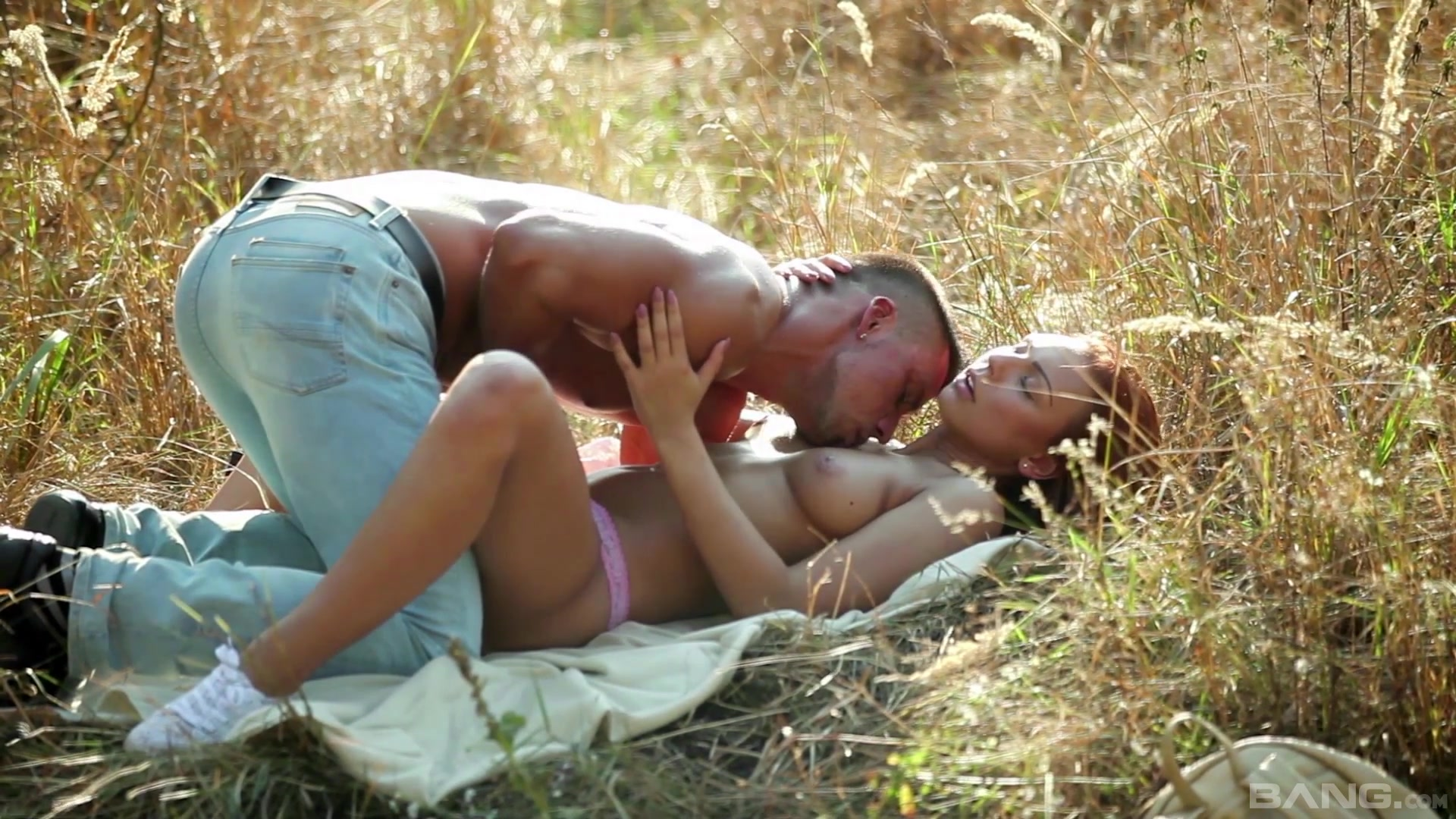 Redhead sucks dick in the sun and loves the sperm on her boobs