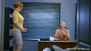 Busty redhead is keen to try a bit of hard sex at the office